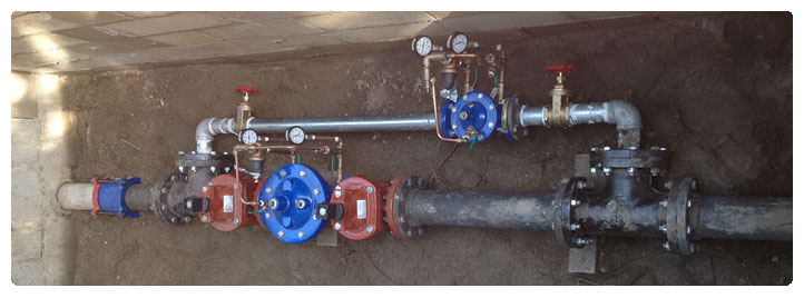 Photo of production meter and valves at California Pines District well