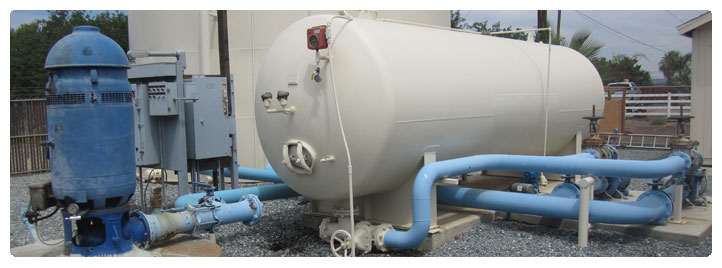 Photo of well head booster tank and pump and storage tank at Country Estates District