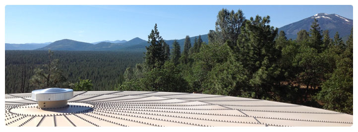 Photo taken from the top of the Johnson Park District storage tank showing the Sierra Nevada mountain range in the background